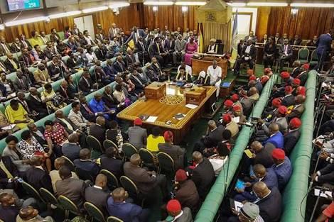 -In set is the ruling majority government side (left) the opposition side (right) putting on red huts and (Central) are independent MPs during the presidential age limit debate.